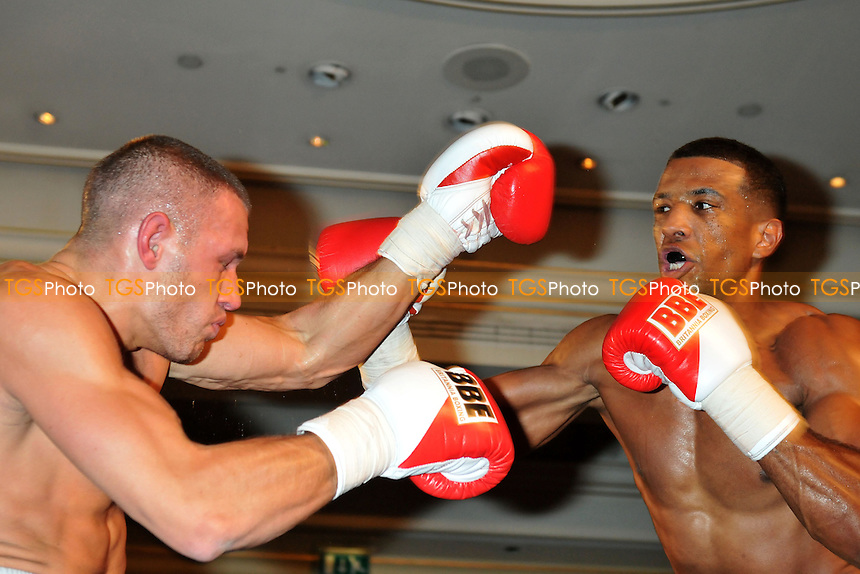 Craig Kennedy (black/gold shorts) defeats Stanislas Makernko in a boxing contest at the Millenium Hotel, London - 29/11/13 - MANDATORY CREDIT: Philip Sharkey/TGSPHOTO - Self billing applies where appropriate - 0845 094 6026 - contact@tgsphoto.co.uk - NO UNPAID USE