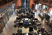 NWA Democrat-Gazette/J.T. WAMPLER A former farm supply store in Bentonville was remodeled for RevUnit where employees work Thursday March 15, 2018. RevUnit is a digital product development firm.