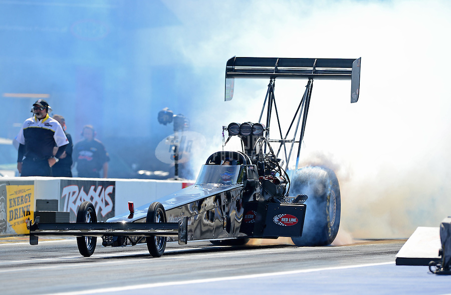 Apr. 13, 2012; Concord, NC, USA: NHRA top fuel dragster driver Brady Kalivoda during qualifying for the Four Wide Nationals at zMax Dragway. Mandatory Credit: Mark J. Rebilas-