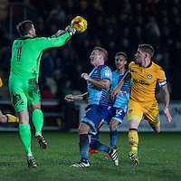 Joe Day of Newport County punches away from Garry Thompson of Wycombe Wanderers during the Sky Bet League 2 match between Newport County and Wycombe Wanderers at Rodney Parade, Newport, Wales on 22 November 2016. Photo by Mark  Hawkins.