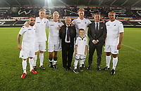(L-R) Current and former players and managers, Leon Britton, Garry Monk, Alan Curtis, Brian Flynn, Alan Tate with his son, Brendan Rodgers and Roberto Martinez during the Swansea Legends v Manchester United Legends at The Liberty Stadium, Swansea, Wales, UK. Wednesday 09 August 2017