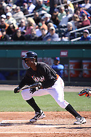 Miami Marlins Juan Pierre (9) takes a bunt against the New York Mets during a spring training game at the Roger Dean Complex in Jupiter, Florida on March 3, 2013. Miami defeated New York 6-4. (Stacy Jo Grant/Four Seam Images)........