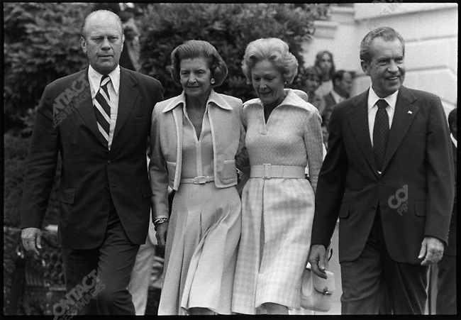 Former President Richard Nixon and his wife (right, and center right) are escorted from the White House by Vice-president Gerald Ford and his wife (left and center left) to a waiting chopper, following Nixon's resignation from the Presidency. Washington, D.C., June 1974