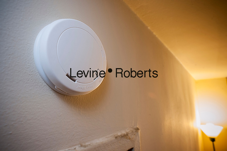 A 10 year smoke detector with a non-removable battery on the wall of an apartment in New York on Friday, September 9, 2016. The older models are prone to people pulling out the batteries to prevent cooking from setting off the alarm. (© Richard B. Levine)