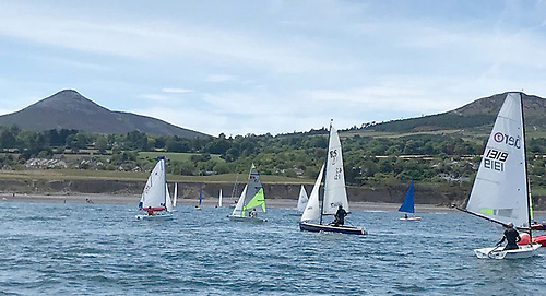 An RS Aero is part of the dinghy scene under the Sugerloaf at Greystones Bay