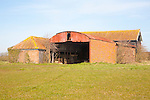 Barn used for farm storage in field at Easton, Suffolk, England - the UK government is loosening planning restrictions on the conversion of barns to housing.