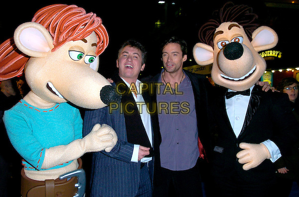 "SHANE RICHIE & HUGH JACKMAN.The premiere of ""Flushed Away"" at the Empire, Leicester Square, London, UK..November 23rd, 2006.half length black blue coat purple shirt arms linked costume.CAP/CAN.©Can Nguyen/Capital Pictures"