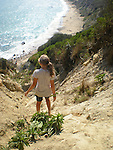 Girl, 11, negotiating the steep, sandy cliff above the sea at<br /> Mohegan Bluffs, Block Island