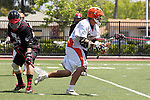 Orange, CA 05/02/10 - Andrew Hauke (CS Fullerton # 2) and Justin Harrington (Biola # 7) in action during the Biola-Cal State Fullerton MCLA SLC Division II final game in Wilson Field at Chapman University.  CS Fullerton earned a consecutive appearance at the Nationals by defeating Biola 12-7.
