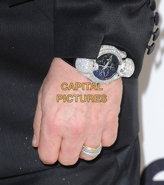 Elton John's hand.The 21st Annual Elton John AIDS Foundation Academy Awards Viewing Party held at The City of West Hollywood Park in West Hollywood, California, USA..February 24th, 2013.oscars black detail wristwatch ring silver diamonds .CAP/DVS.©DVS/Capital Pictures.