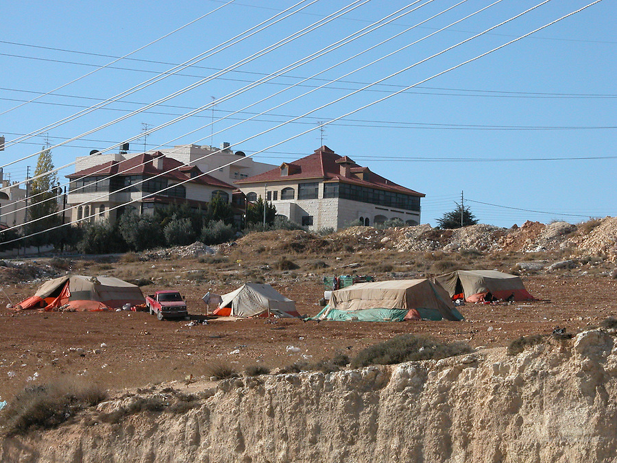 people in amman live in houses, but some live in tents