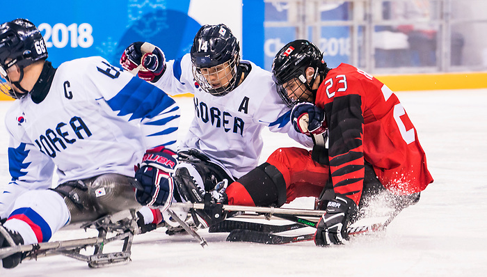 PyeongChang 15/3/2018 - Liam Hickey (#23), of St. John's, NL, drives the net as Canada takes on Korea in semifinal hockey action at the Gangneung Hockey Centre during the 2018 Winter Paralympic Games in Pyeongchang, Korea. Photo: Dave Holland/Canadian Paralympic Committee
