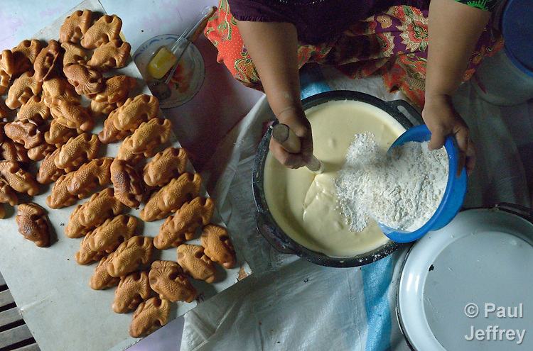 Zaitun mixes the ingredients as she bakes pastries in her home in Banda Aceh, on Indonesia's Sumatra Island. The family lost their house and belongings in the 2004 tsunami. The government provided them with a new house. Church World Service, a member of the ACT Alliance, loaned Zaitun and other women in the neighborhood the money they needed to purchase new equipment and ingredients to restart their businesses. The women repaid their loans to a revolving fund that they jointly manage. Zaitun has used the profits from her pastry business to keep her four children in school.