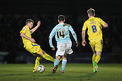 15.01.2013. Torquay, England. Torquay Captain Lee Mansell tackles Exeter's Tommy Doherty during the League Two game between Torquay United and Exeter City from Plainmoor.