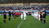 Alan Tate with his two children walks through a Guard of Honour made out of former Swansea and Manchester United players during the Swansea Legends v Manchester United Legends at The Liberty Stadium, Swansea, Wales, UK. Wednesday 09 August 2017