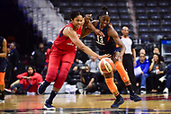 Washington, DC - June 3, 2018: Washington Mystics center Krystal Thomas (34) and Connecticut Sun forward Chiney Ogwumike (13) fight for a lose ball during game between the Washington Mystics and Connecticut Sun at the Capital One Arena in Washington, DC. (Photo by Phil Peters/Media Images International)