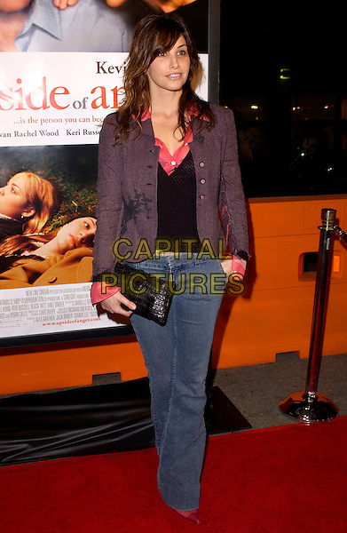 GINA GERSHON.Attends New Line Cinema's World Premiere of Upside of Anger held at the Mann National Theatre in Westwood, California  .March 3rd 2005.full length jeans denim purple blazer jacket black clutch purse.www.capitalpictures.com.sales@capitalpictures.com.Supplied By Capital PIctures