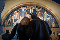 Couple looks at mural above the tabernacle during an open house at the  new St. Paul's Catholic Church in Westerville.