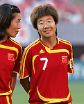 16 June 2007: China's Bi Yan (7) and Pu Wei (left), pregame. The United States Women's National Team defeated the Women's National Team of China 2-0 at Cleveland Browns Stadium in Cleveland, Ohio in an international friendly game.