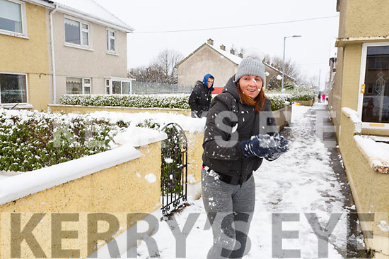 Andrea Dolan in Shanakill on Friday morning getting ready to defend the in coming snowballs.