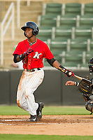 Kannapolis Intimidators shortstop Tim Anderson (2) follows through on his swing against the West Virginia Power at CMC-Northeast Stadium on July 9, 2013 in Kannapolis, North Carolina.  The Power defeated the Intimidators 3-1.   (Brian Westerholt/Four Seam Images)