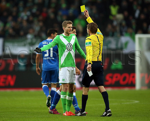 07.02.2015. Wolfsburg, Germany. Bundesliga football league match. VFL Wolfsburg versus TSG Hoffenheim at the  Volkswagen-Arena Wolfsburg. New signing  Andre Schurrle gets a yellow card on his debut