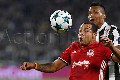 27th September 2017, Allianz Stadium, Turin, Italy; UEFA Champions League, Juventus versus Olympiacos; Felipe Pardo shields the high ball from Alex Sandro