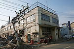 April 15, 2011, Ishinomaki, Miyagi, Japan - A power pole and car destroyed by the March 11 Tsunami. The 9.0 Earthquake and the Tsunami left 13,700 dead and at least 14,000 missing. (Photo by B.Meyer-Kenny/2.0 images)