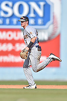 Charleston RiverDogs shortstop Kyle Holder (4) reacts to play during game one of a double header against the Asheville Tourists at McCormick Field on July 8, 2016 in Asheville, North Carolina. The RiverDogs defeated the Tourists 10-4 in game one. (Tony Farlow/Four Seam Images)