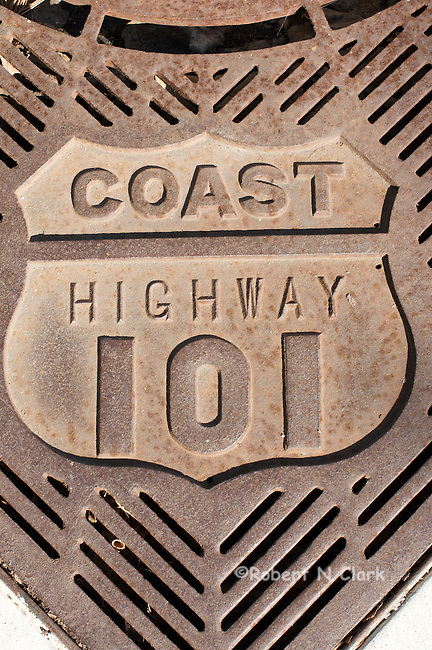 Coast Highway 101 on drainage grate around tree planter
