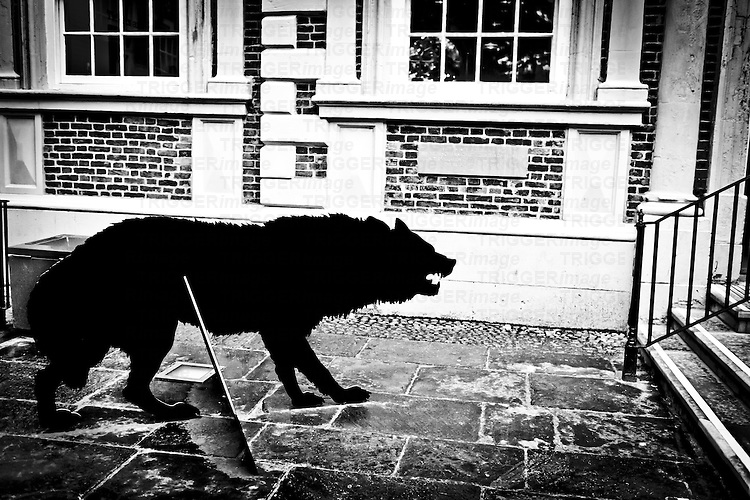 Menacing cardboard cutout of a wolf outside the Bluecoat Gallery in Liverpool. daylight outdoor shot