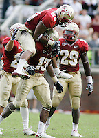 TALLAHASSEE, FL 10/31/09-FSU-NCST FB09 CH51-Florida State's Dekoda Watson, top, celebrates with Nigel Bradham during the final series against N.C. State, Saturday at Doak Campbell Stadium in Tallahassee. The Seminoles beat the Wolf Pack 45-42..COLIN HACKLEY PHOTO
