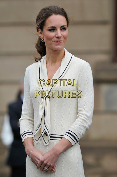 The Duke and Duchess of Cambridge.Royal Tour of Canada.Leaving Provence House, Prince Edward Island, Canada 4th July 2011.Prince William Catherine knitted dress nautical pussy bow striped trim half length.CAP/CAS.©Bob Cass/Capital Pictures.