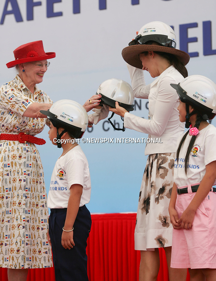 """Queen Margrethe and Crown Princess Mary.Visit Maersk to promote a helmet wearing campaign with street children. Ho Chi Minh City Vietnam_06/11/2009..Mandatory Photo Credit: ©Dias/Newspix International..**ALL FEES PAYABLE TO: """"NEWSPIX INTERNATIONAL""""**..PHOTO CREDIT MANDATORY!!: NEWSPIX INTERNATIONAL(Failure to credit will incur a surcharge of 100% of reproduction fees)..IMMEDIATE CONFIRMATION OF USAGE REQUIRED:.Newspix International, 31 Chinnery Hill, Bishop's Stortford, ENGLAND CM23 3PS.Tel:+441279 324672  ; Fax: +441279656877.Mobile:  0777568 1153.e-mail: info@newspixinternational.co.uk"""
