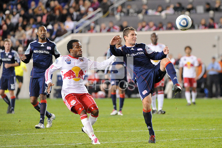 Chris Tierney (8) of the New England Revolution clears the ball away from Dane Richards (19) of the New York Red Bulls. The New York Red Bulls defeated the New England Revolution 2-0 during a Major League Soccer (MLS) match at Red Bull Arena in Harrison, NJ, on October 21, 2010.