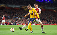 Antoine Griezmann of Atletico Madrid & Shkodran Mustafi of Arsenal during the UEFA Europa League Semi Final 1st leg match between Arsenal and Atletico Madrid at the Emirates Stadium, London, England on 26 April 2018. Photo by Andy Aleksiejczuk / PRiME Media Images