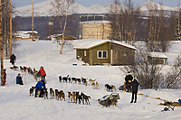 Sebastian Schunelle runs through Kaltag as other teams leave after resting on Sunday morning in Kaltag during Iditarod 2008