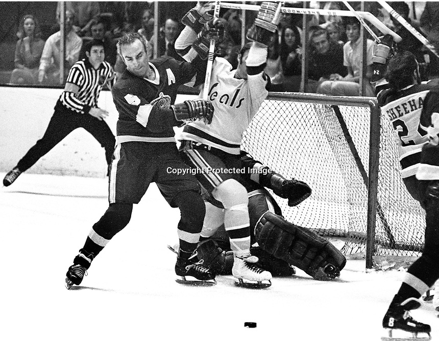 Seals vs LA Kings #5 Harry Howell checks Seal Wayne Carleton in front of goalie Gary Edwards. (1971 photo/Ron Riesterer)
