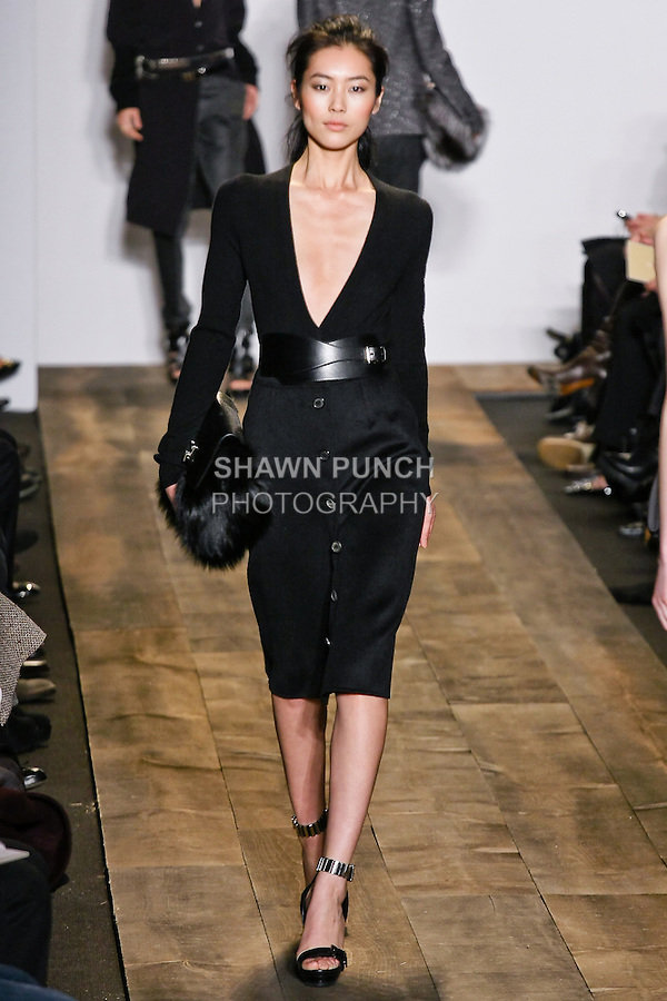 Liu Wen walks the runway in a black stretch cashmere bodysuit, and black doubleface cashgora skirt at the Michael Kors Fall 2010 runway fashion show, during Mercedes-Benz Fashion Week Fall 2010.