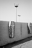 Tijuana, Mexico<br /> August 18, 2007<br /> <br /> While a high powered camera towers armed with night vision cameras and monitored 24/7 watches over the fence from the US side the Mexican side is covered in memorials for the hundreds who have died attempting to cross the border.