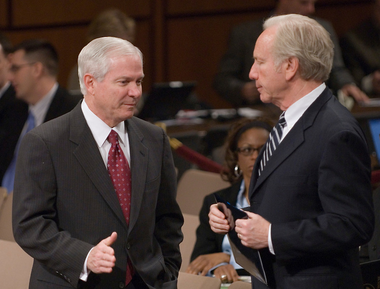 Defense Secretary Robert Gates speaks with Sen. Joe Lieberman, I-Ct., before the start of the Senate Armed Services Committee hearing on Iraq on Friday, Jan. 12, 2007.