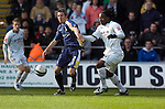 Coca-Cola Football League Championship - Swansea City v Cardiff City @ The Liberty Stadium in Swansea..Cardiff's Kevin McNaughton (2) is caught by Jason Scotland of Swansea..
