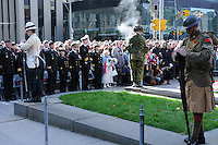 Three silent sentries on solem guard amidst Canadian Armed Forces Officers and Torontonians during the Remembrance Day ceremony at Old City Hall in Toronto, Ontario, Canada, November 11, 2011.