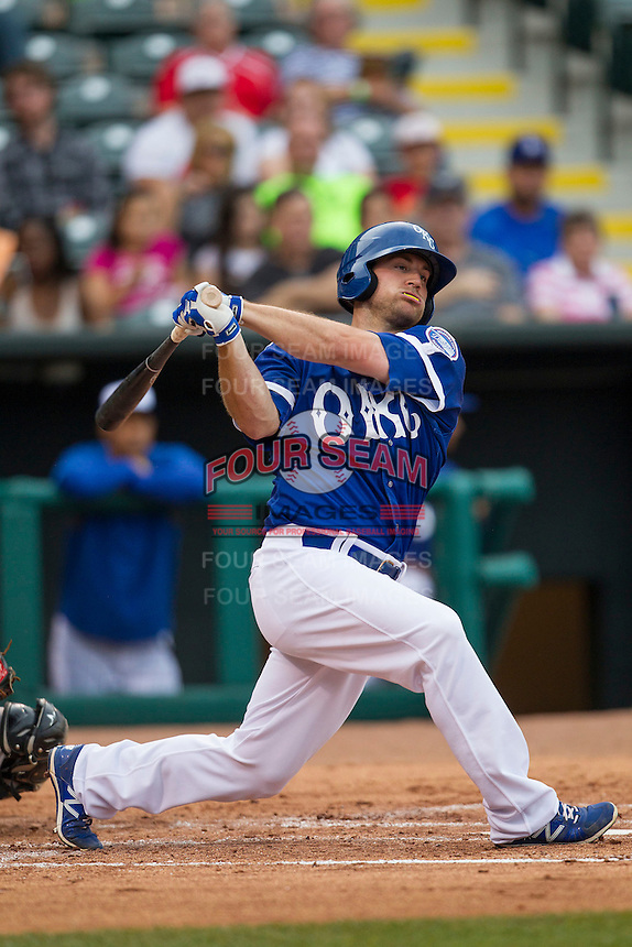 Oklahoma City Dodgers outfielder Scott Schebler (8) follows through on his swing during the Pacific Coast League baseball game against the Nashville Sounds on June 12, 2015 at Chickasaw Bricktown Ballpark in Oklahoma City, Oklahoma. The Dodgers defeated the Sounds 11-7. (Andrew Woolley/Four Seam Images)