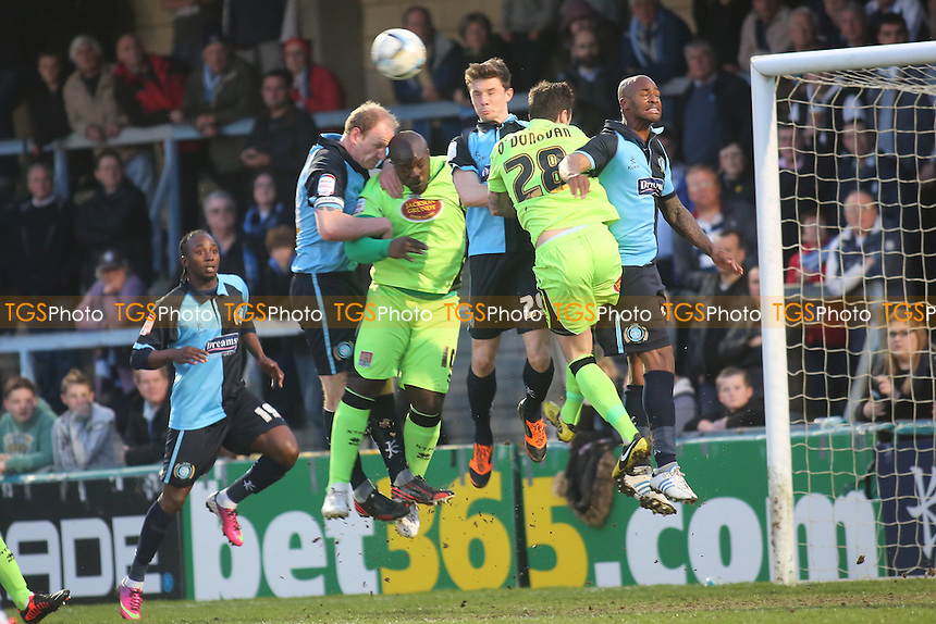 Wycombe's Matt McClure clears the ball under pressure from the Northampton attack - Wycombe Wanderers vs Northampton Town - NPower League Two Football at Adams Park, High Wycombe - 16/04/13 - MANDATORY CREDIT: Paul Dennis/TGSPHOTO - Self billing applies where appropriate - 0845 094 6026 - contact@tgsphoto.co.uk - NO UNPAID USE.