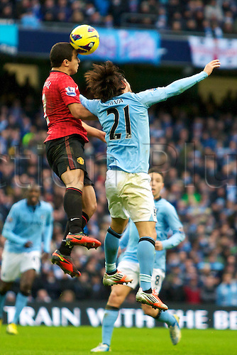 09.12.2012 Manchester, England. Manchester City's Spanish midfielder David Silva and Manchester United's Brazilian defender Rafael in action during the Premier League game between Manchester City and Manchester United from the Etihad Stadium. Manchester United scored a late winner to take the game 2-3.