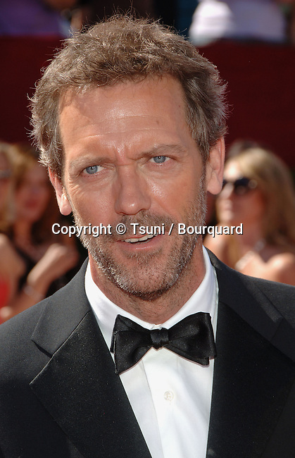 Hugh Laurie arriving at the at the 58th Emmys Awards at The SHRINE AUDITORIUM  in Los Angeles. August 27, 2006.<br /> <br /> headshot
