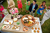USA, Tennessee, Nashville, Iroquois Steeplechase, friends stand around a buffet table eating and drinking