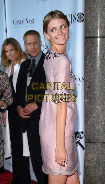 MISCHA BARTON.Conde Nast Media Group's Third Annual Fashion Rocks Concert at Radio City Music Hall, New York, NY, USA,.7 September 2006..half length looking back over shoulder pink lilac purple tunic dress beaded jewel encrusted sleeves collar.Ref: ADM/PH.www.capitalpictures.com.sales@capitalpictures.com.©Paul Hawthorne/AdMedia/Capital Pictures. *** Local Caption ***