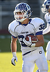 Carson's Dylan Sawyers runs in the NIAA 4A northern region football championship game between Reed High and Carson High on Saturday, Nov. 26, 2011, in Reno, Nev. Reed won 49-0 advancing to the state title game next Saturday against Bishop Gorman. .Photo by Cathleen Allison